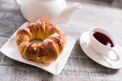 Cup of fruit tea with croissant Stock Photo