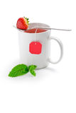 Cup of fruit tea with strawberry as teabag stock images