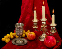 Cup fruits and candles Royalty Free Stock Photo
