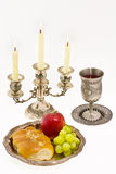 Cup fruits and candlestick Royalty Free Stock Image