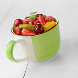 Cup with fruits Royalty Free Stock Images