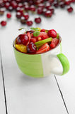 Cup with fruits Royalty Free Stock Photos