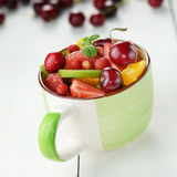 Cup with fruits Stock Images
