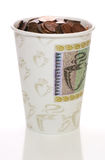 Cup full of change Stock Photography