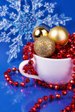 A cup full of Christmas decoration and snowflake Stock Images