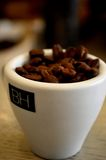 Cup full of coffe beans Royalty Free Stock Image