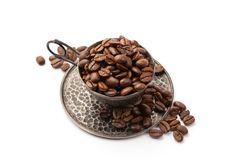 Cup full of coffee beans Stock Photos