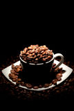Cup full of coffee beans Royalty Free Stock Photos