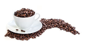 Cup full of coffee beans. On white Royalty Free Stock Images
