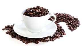 Cup full of coffee beans. On white Stock Photo