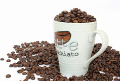 Cup full of coffee beans Stock Photo