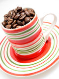Cup Full of Coffee Beans Royalty Free Stock Photo