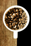 Cup full of coffee beans Stock Photography
