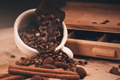 Cup full of coffee beans and chocolate Royalty Free Stock Images