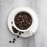 Cup full of coffee beans Royalty Free Stock Photography