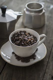 Cup full of coffee beans Royalty Free Stock Images