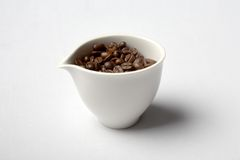 Cup full of colombian coffee beans Stock Image
