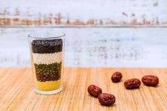 A cup full of grain and miscellaneous grains royalty free stock image