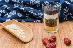 A cup full of grain and miscellaneous grains stock photography