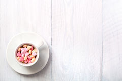 Cup full of heart shaped candies Royalty Free Stock Photos