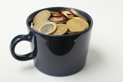 Cup full of money Royalty Free Stock Images