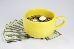Cup Full with Money. On white background Stock Images