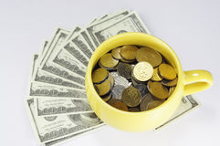 Cup Full with Money. On white background Royalty Free Stock Photos