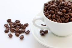 Cup Full Of Coffee Beans Stock Images