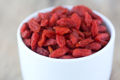 Cup full off dried Goji berries. White Cup full off dried Goji berries Stock Photos