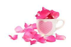 Cup full of rose petals on white background Stock Photo