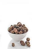 Cup full of shea nuts Royalty Free Stock Image