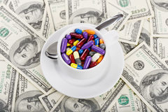 Cup full of tablets and pills. (installation on the theme of modern medicine trends royalty free stock photography