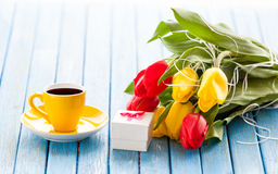 Cup and gift box with bouquet of tulips Royalty Free Stock Photo