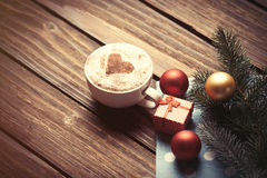 Cup and gift box with christmas bubbles Stock Photo