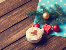 Cup and gift box with christmas bubbles Royalty Free Stock Photo