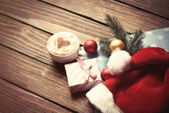 Cup and gift box with christmas bubbles Royalty Free Stock Photos