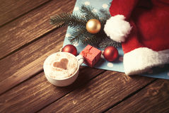 Cup and gift box with christmas bubbles Royalty Free Stock Photography