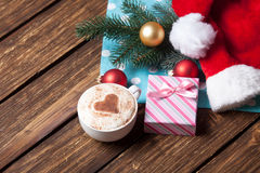 Cup and gift box with christmas bubbles Royalty Free Stock Images