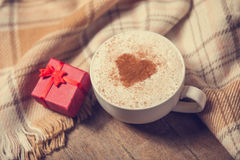 Cup and gift Royalty Free Stock Photography