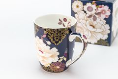 Cup gift with decorated porcelain mug / cup in foreground and g stock images