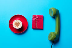 Cup, gift and handset Stock Photography