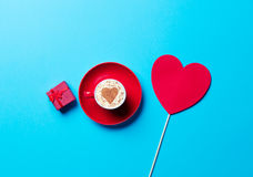 Cup, gift and toy Stock Photography