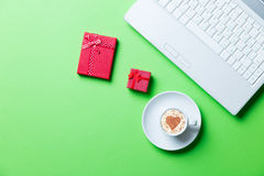 Cup, gifts and laptop Royalty Free Stock Photos