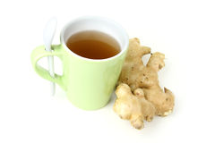 Cup of ginger tea. A cup of ginger tea with fresh ginger Royalty Free Stock Photography