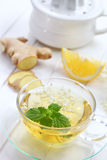 Cup of ginger tea Stock Image