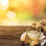 Cup of ginger tea with cookie on grunge wooden table . Royalty Free Stock Image