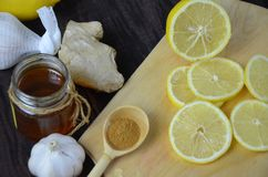 Cup of ginger tea with honey and lemon on wooden table royalty free stock image