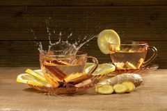 A cup of ginger tea with lemon Royalty Free Stock Images