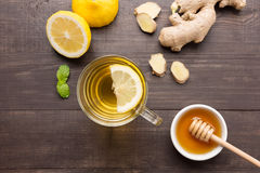 Cup of ginger tea with lemon, ginger, honey on wooden background Stock Photography