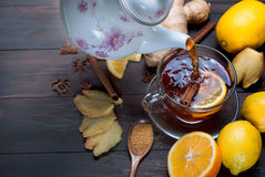 Cup of Ginger tea with lemon and honey on dark brown wooden  bac. Kground, top view, copy space Stock Photos
